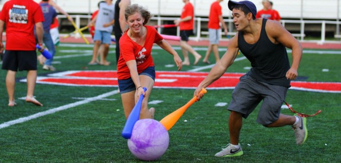 College students jousting with a madeup recreation sport. Matthew Pendleton, Lisa Knapek.