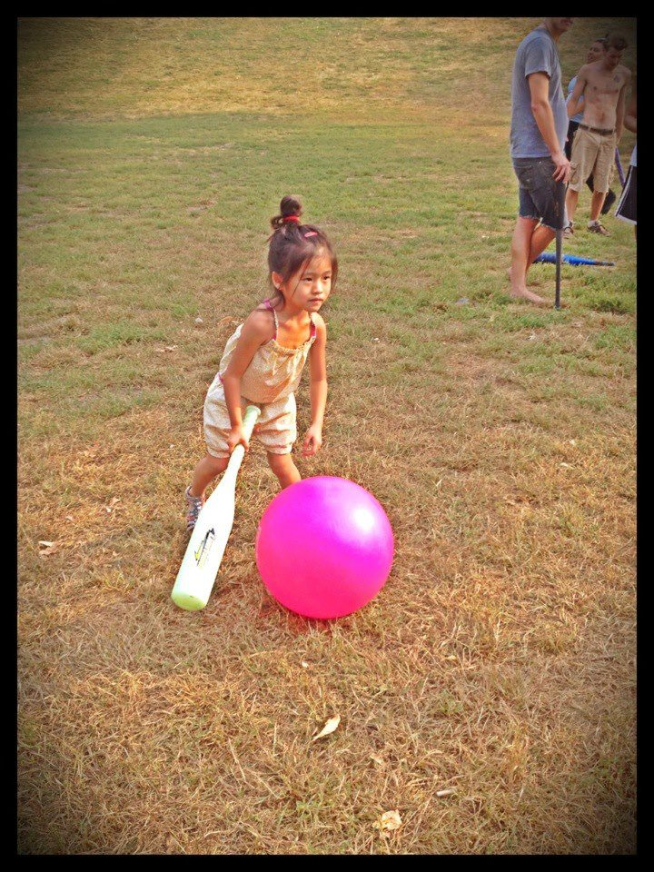 Cute toddler girl playing an outdoor game. Johnball is a sport for all ages, all sizes.