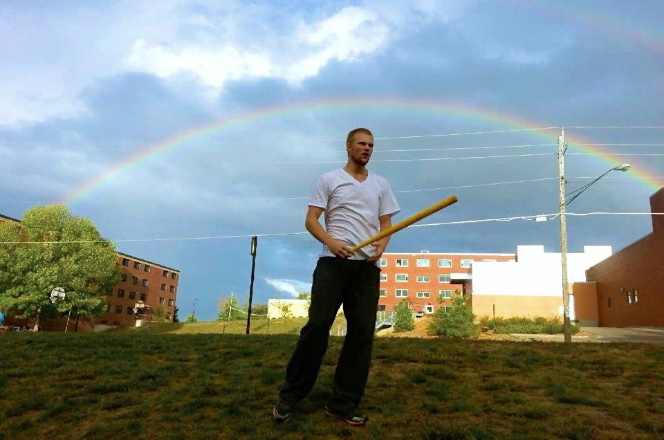 A game from Lakeville Minnesota makes its way to Wisconsin Stout. Beautiful nature: dark clouds, shadows, and a freakin rainbow. Slightly handsome guy too.