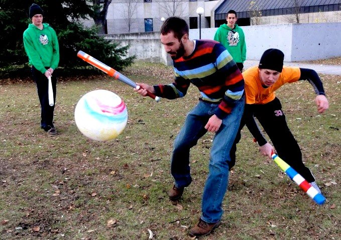 Cody Troop with more college students at UND Grand Forks, playing Johnball in the ring of death. Vinyl balls being struck by plastic baseball bats. A Sport invented by John Hilsen, inspired by Calvinball.