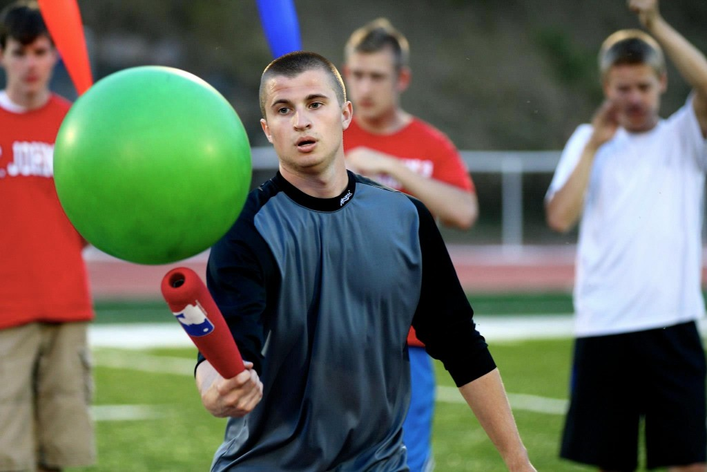 A Single Man. Playing Johnball, a invented sport where you use plastic or foam wiffleball bats to hit large vinyl balls at other johnballers.