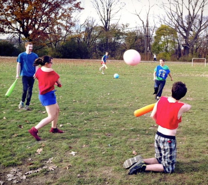 William Bird, Sam Mohler, and other hooligan cutiebuns from University of Pittsburgh play the wiffleball bat, large rubber ball sport of Johnball in a grassy knoll.