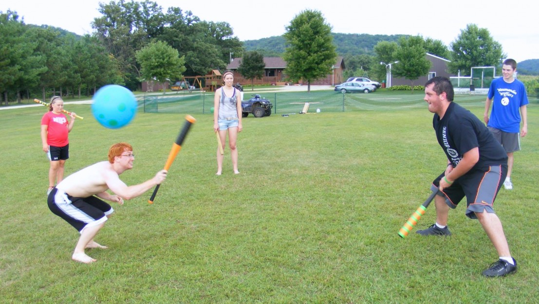 Andrew Petz and kooky komrades equip themselves with big plastic wiffle ball bats and large rubber play balls from WalMart, Target. Time for a game of Johnball, they scream.