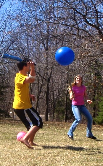 JoVanna Jensen versus Andrew Christensen playing the sport, game of Johnball for outdoorfun.